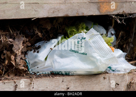 compostable plastic bag in compost heap - Stock Photo