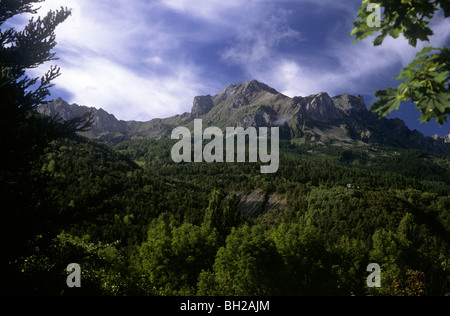 Mountain in French Alps near Gap with cirro-stratus clouds in the sky - Stock Photo