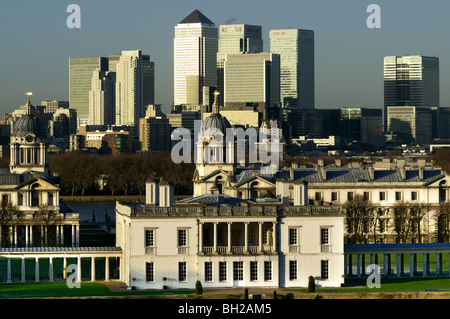 Queen's house, old Royal Naval College, and Canary Wharf skyline seen from Greenwich Park - Stock Photo