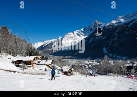 View over the resort & the drag lift on the nursery slopes by Le Brevent gondola, Chamonix Mont Blanc, Haute Savoie, - Stock Photo