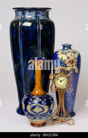 A Group Of Art Nouveau Antiques A Clock Two English Doulton Vases
