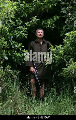 Hunter Keith Marshall in native bush at The Brook Waimarama Sanctuary, Nelson, New Zealand - Stock Photo
