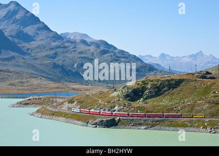 RHAETISCHE BAHN RHAETIAN TRAIN, BERNINA PASS, ARTIFICAL LAKE LAGO BIANCO, ENGADINE, GRISONS, SWITZERLAND - Stock Photo