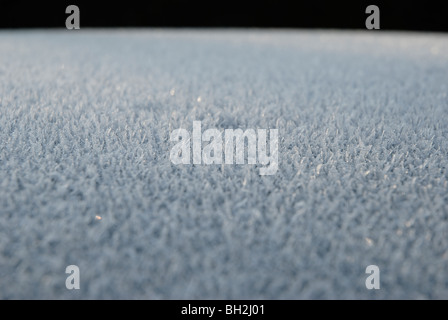 Abstract image of a layer of frost on the roof of a car. - Stock Photo