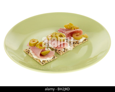 Multigrain Crackers with Ham and Olives - Stock Photo
