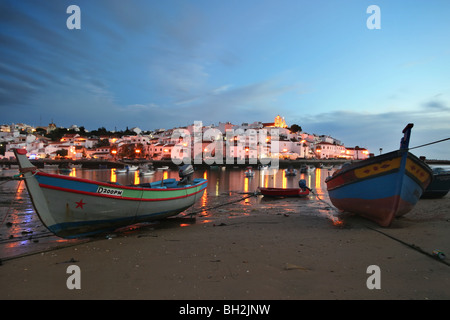 Fishing boats on a safe shelter- Ferragudo, Algarve, Portugal - Stock Photo