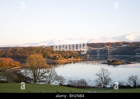Isle of Anglesey North Wales UK January View across Menai Strait and Thomas Telford's Suspension bridge in late - Stock Photo