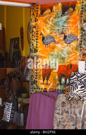 Clothing and curios on sale at a curio shop in Howick on the Midlands Meander, Kwazulu Natal, South Africa. - Stock Photo