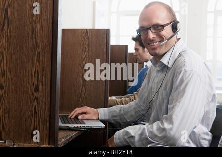 Portrait of call a call center operator - Stock Photo