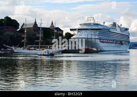 Cruise ship Crown Princess moored below the the fortress of Akershus Fastning, Oslo, Norway - Stock Photo