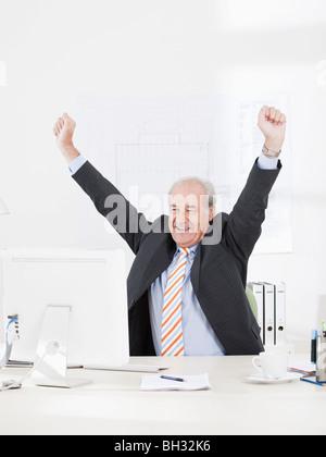 Senior businessman jubilating - Stock Photo