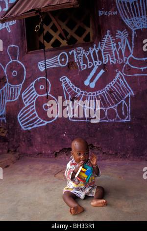 BABY PLAYING CLOSE TO HIS HOME, BOBO-DIOULASSO, BURKINA FASO - Stock Photo