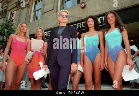 Fashion designer Liza Bruce protests with models to shareholders outside the Marks and Spencer AGM over a copyright dispute.