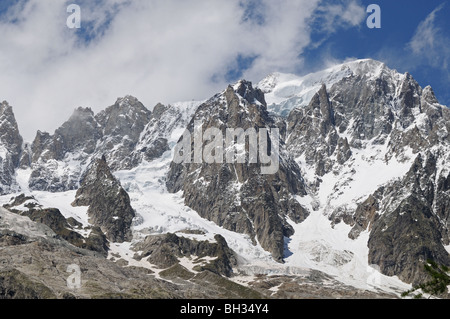 Rocky southern side of alpine peaks of Grandes Jorasse seen from Entreves Courmayeur Italy - Stock Photo