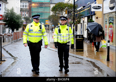 Two Police Community Support Officers walk on their beat in George St Hove