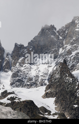 Close up of south west face of rocky alpine peaks of Grandes Jorasse seen from Entreves Courmayeur Italy - Stock Photo