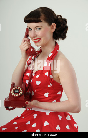 Woman In 1950s Retro Clothing Smelling Her Coooking Stock