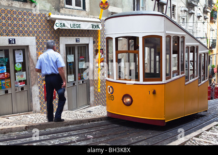 Tram driver on the Elevador da Bica funicular Lisbon Portugal - Stock Photo