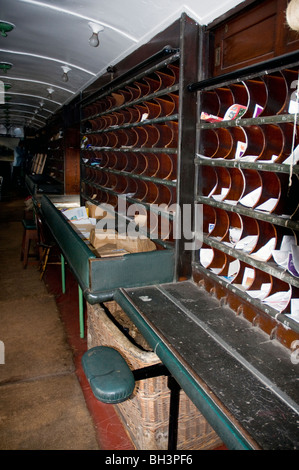 inside view of a traveling post office train carriage - Stock Photo