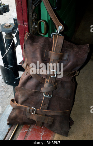 inside view of a traveling post office train carriage showing leather mail satchel - Stock Photo