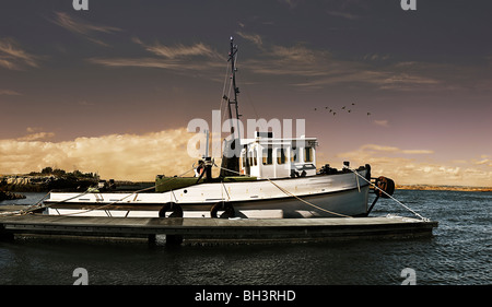 An old wooden fishing trawler ready to go to sea. - Stock Photo