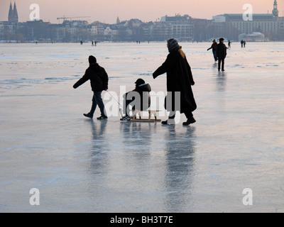 Family on the frozen Alster in Hamburg - Stock Photo