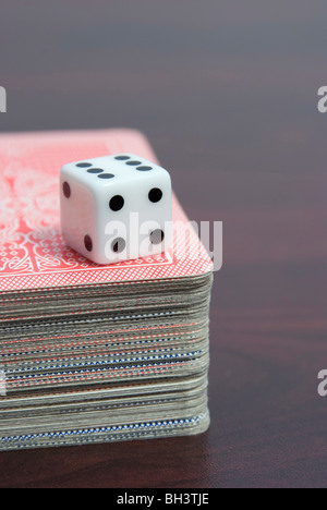 dice on playing cards pack - Stock Photo