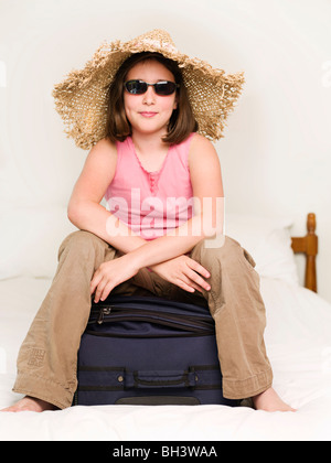 A girl wearing sunglasses and sun hat - Stock Photo