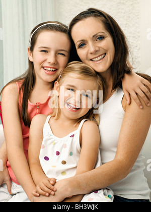 A portrait of a mother and two daughters - Stock Photo