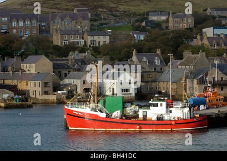 Houses overlook the port and ferry terminal at Stromness, West Mainland, Orkney Islands, Scotland, 18th October - Stock Photo