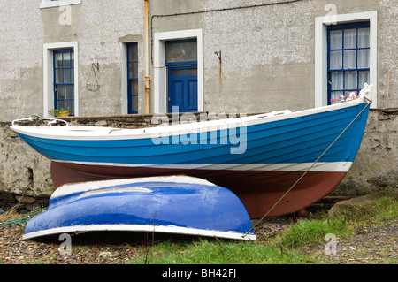 Boats pulled up outside houses who have accress to the port and bay of Stromness, Orkney mainland, 20th October - Stock Photo
