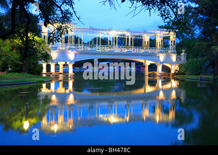 """""""Rosedal""""  of Palermo: Old style bridge at Palermo lakes at dusk, with color boats at background. Buenos Aires, Argentina."""