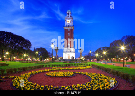 Monumental Tower and park with flowers, at dusk. Retiro neighborhood, Buenos Aires, Argentina, south america. - Stock Photo
