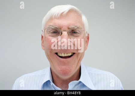 Senior businessman wearing a shirt ( age 60 to 75 years ), laughing - Stock Photo
