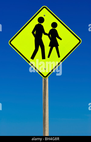 Pedestrian Crossing Sign isolated on a blue gradient sky - Stock Photo