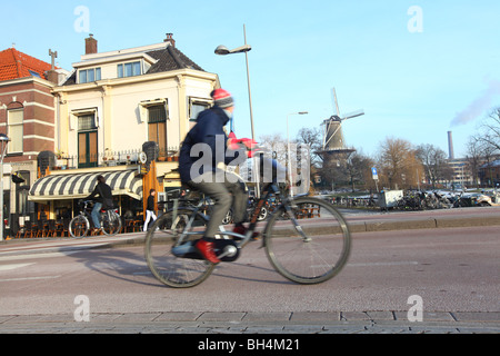 Windmill de Valk and bicycle in the centre of Leiden, Holland, The Netherlands - Stock Photo