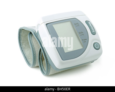 Electronic blood pressure monitor over white background - Stock Photo