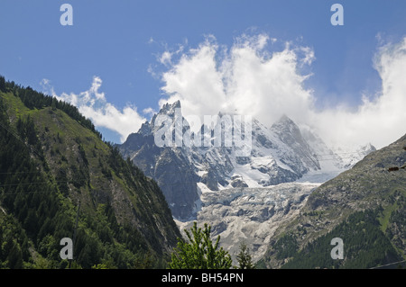 Peaks Aiguille Noire and Blanche de Peuterey Mont Blanc and Brenva Glacier from Courmayeur Valle d'Aosta Italy - Stock Photo