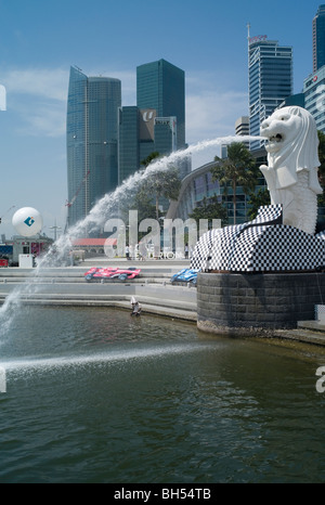 Singapore Lion fountain, Marina Bay, Singapore with city skyline behind at F1 Grand Prix time - Stock Photo