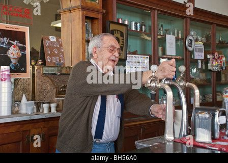 Roy is always busy making delicious treats in his old-fashioned ice cream parlor in Carrizozo, New Mexico. - Stock Photo