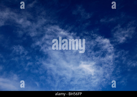 White Wispy Cirrus High clouds deep blue sky - Stock Photo