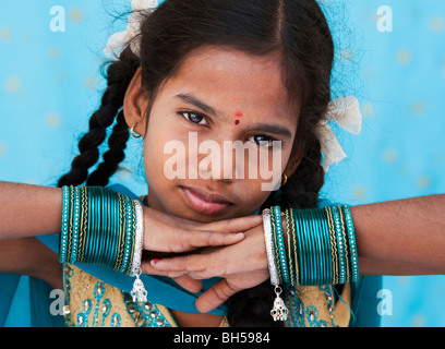 Pretty young indian girl wearing turquoise bangles. Andhra Pradesh. India - Stock Photo