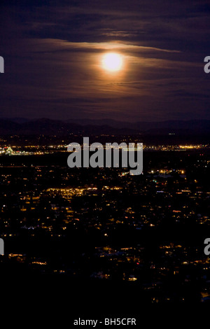 Full Moon rising over San Diego - Stock Photo