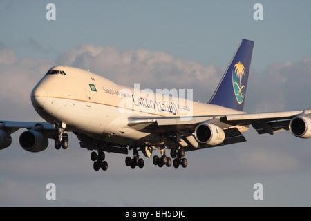 Saudi Arabian Cargo Boeing 747-200F four engine heavy transport aircraft, an adaptation of the jumbo jet, on approach. - Stock Photo