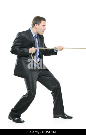 Man pulling a rope, isolated on white background - Stock Photo