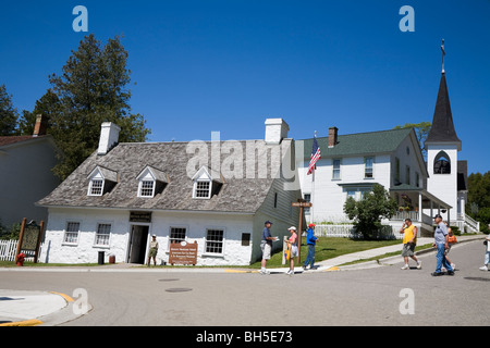 American Fur Company's retail store, Market and Fort Street, with Trinity Episcopal church, Mackinac Island, Michigan, - Stock Photo