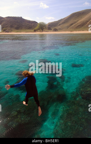 Man jumping into tropical waters, Komodo National Park, Indonesia. No MR (motion blur) - Stock Photo