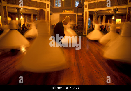 Turkey, Istanbul. The Whirling Dervishes, Sema performance at the Galata Mevlevihanesi - Stock Photo