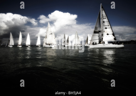 dark sea and sky, with bright, white yachts, 2008, Little Britain Challenge Cup, Cowes, Isle of Wight, UK, England, - Stock Photo