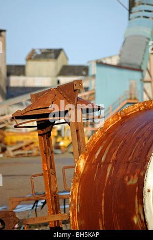 scrap metal in a junk yard - Stock Photo